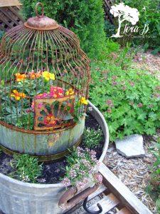 Vintage birdcages in garden pots