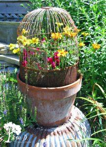 Vintage birdcage in a flower pot