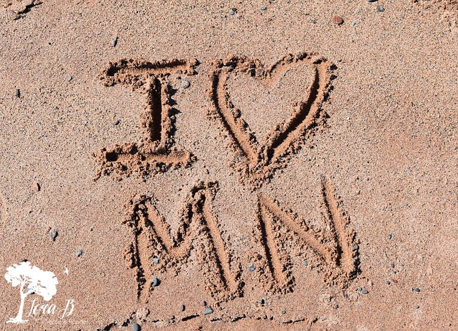 I love MN written in sand