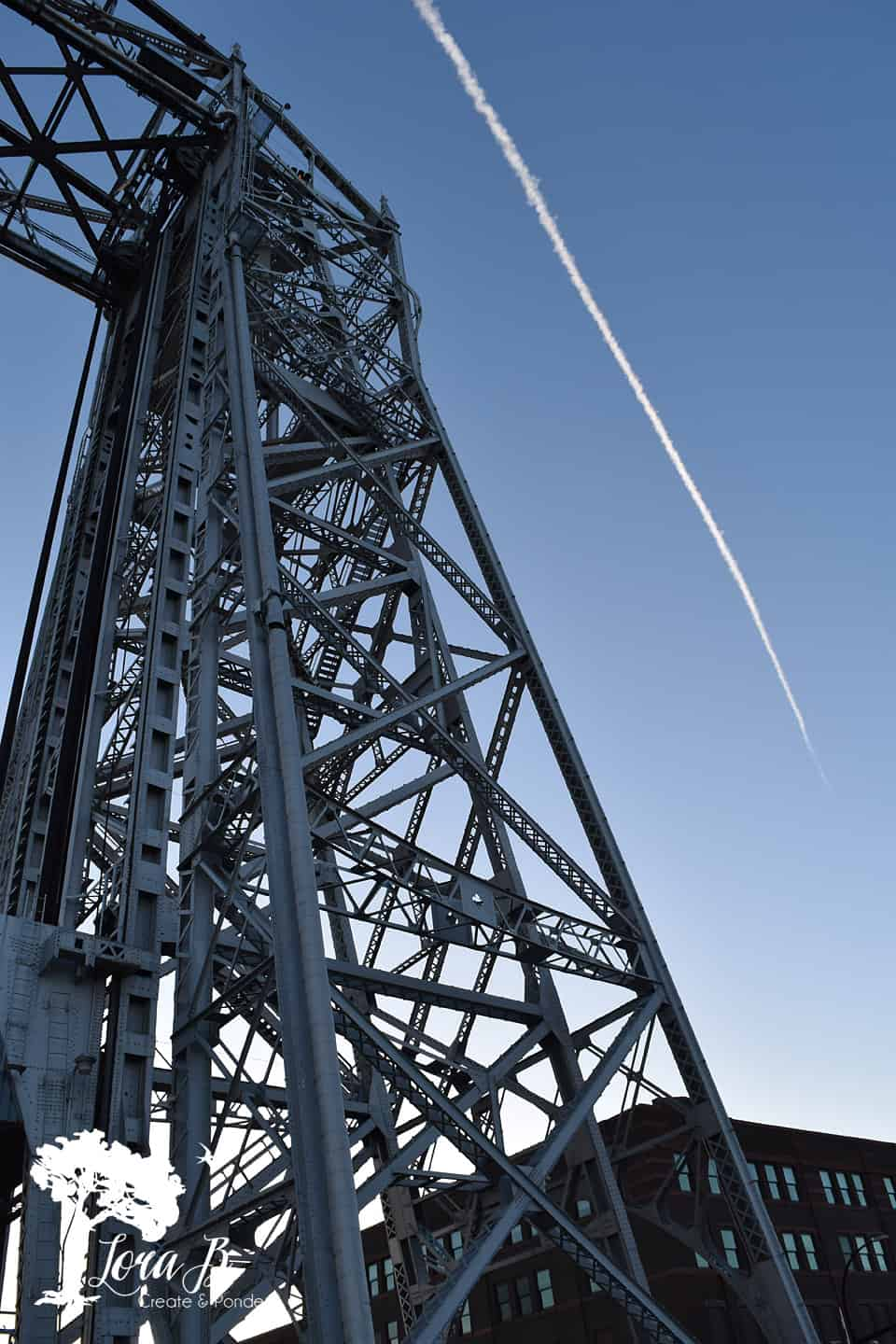 Lift Bridge with contrail overhead