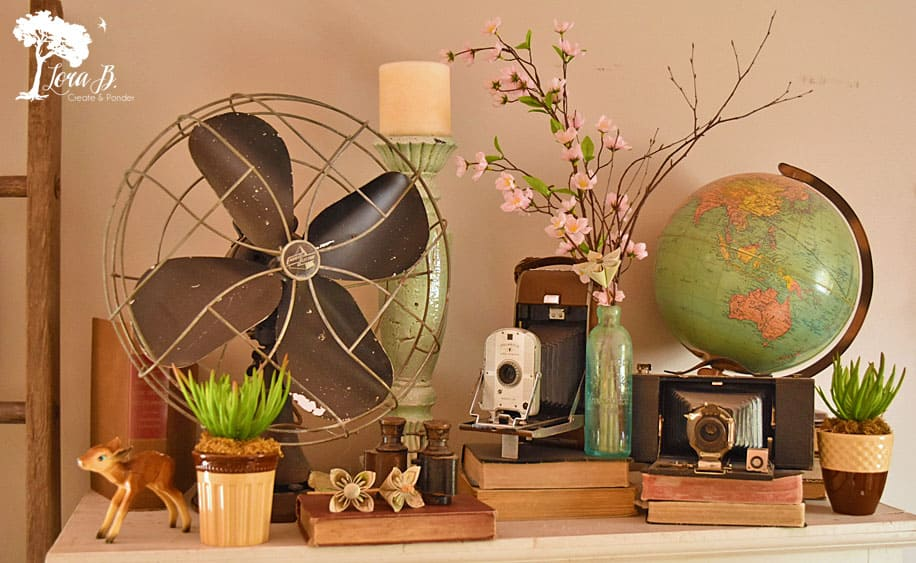Vintage fan, globe, and cameras