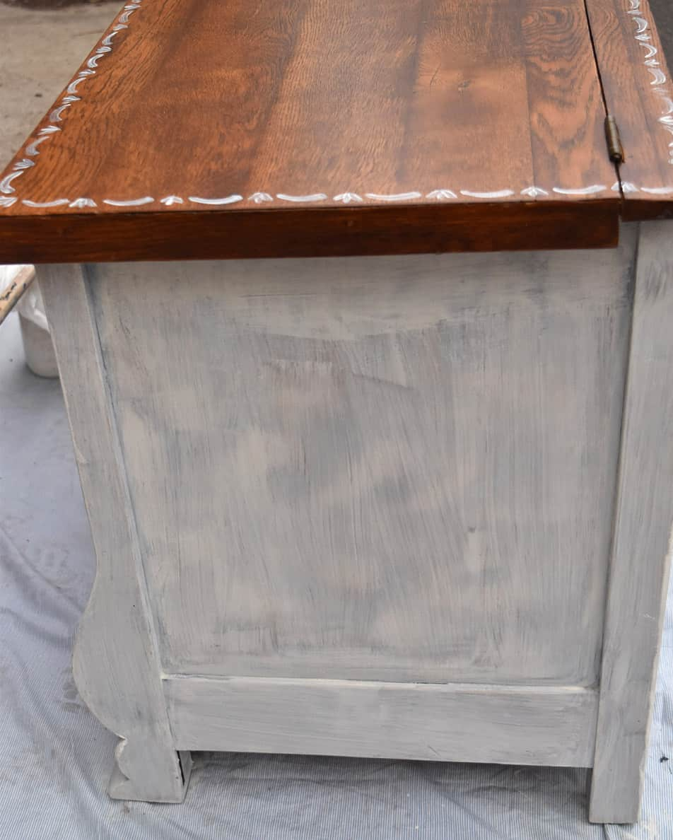 White/wood combination on a vintage furniture piece.