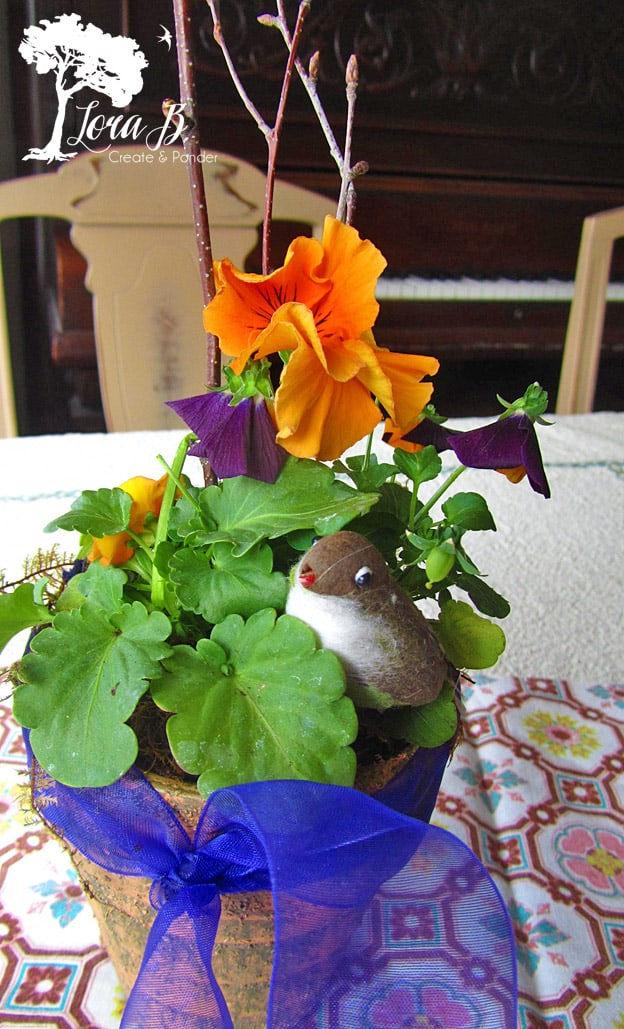 Pansy Pot arrangement with bird.