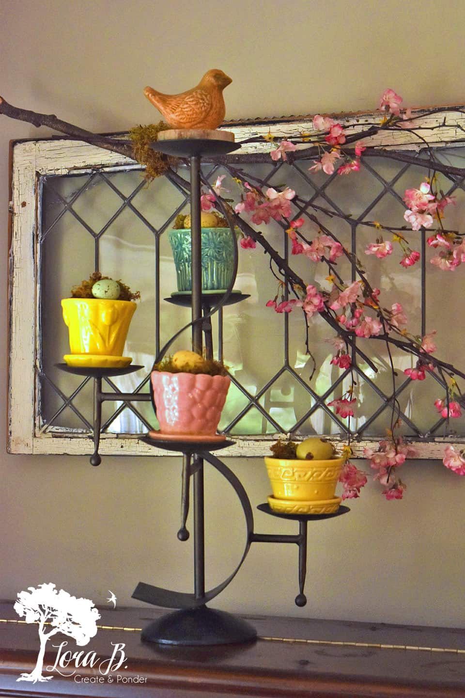 Vintage pottery planters displayed on a tiered candleholder