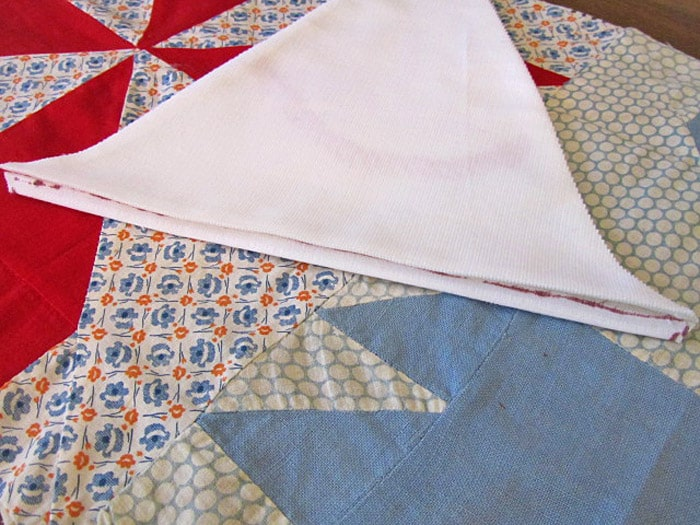 Folded and pressed triangle for bunting.