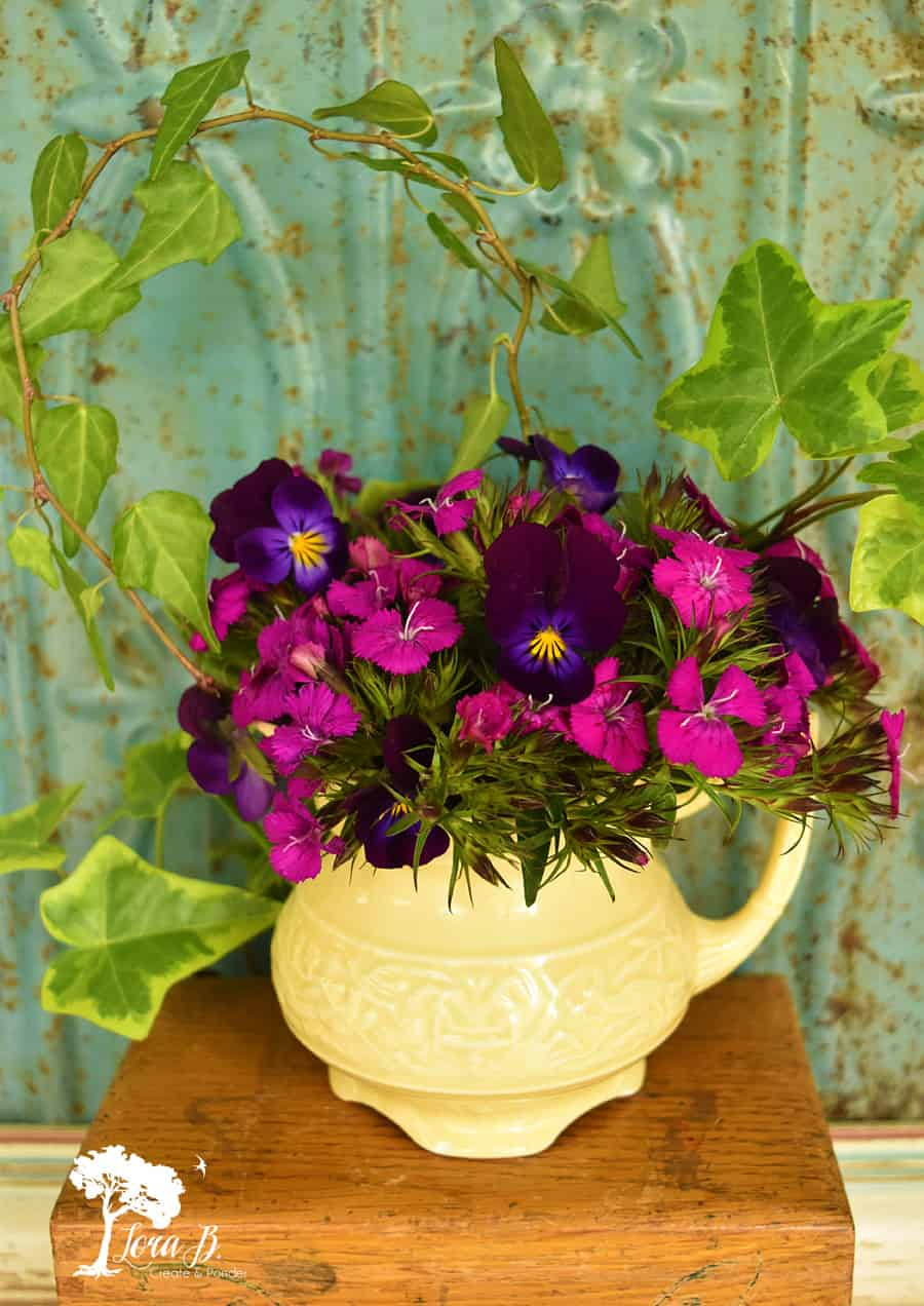 Purple wild violets in a yellow pitcher.