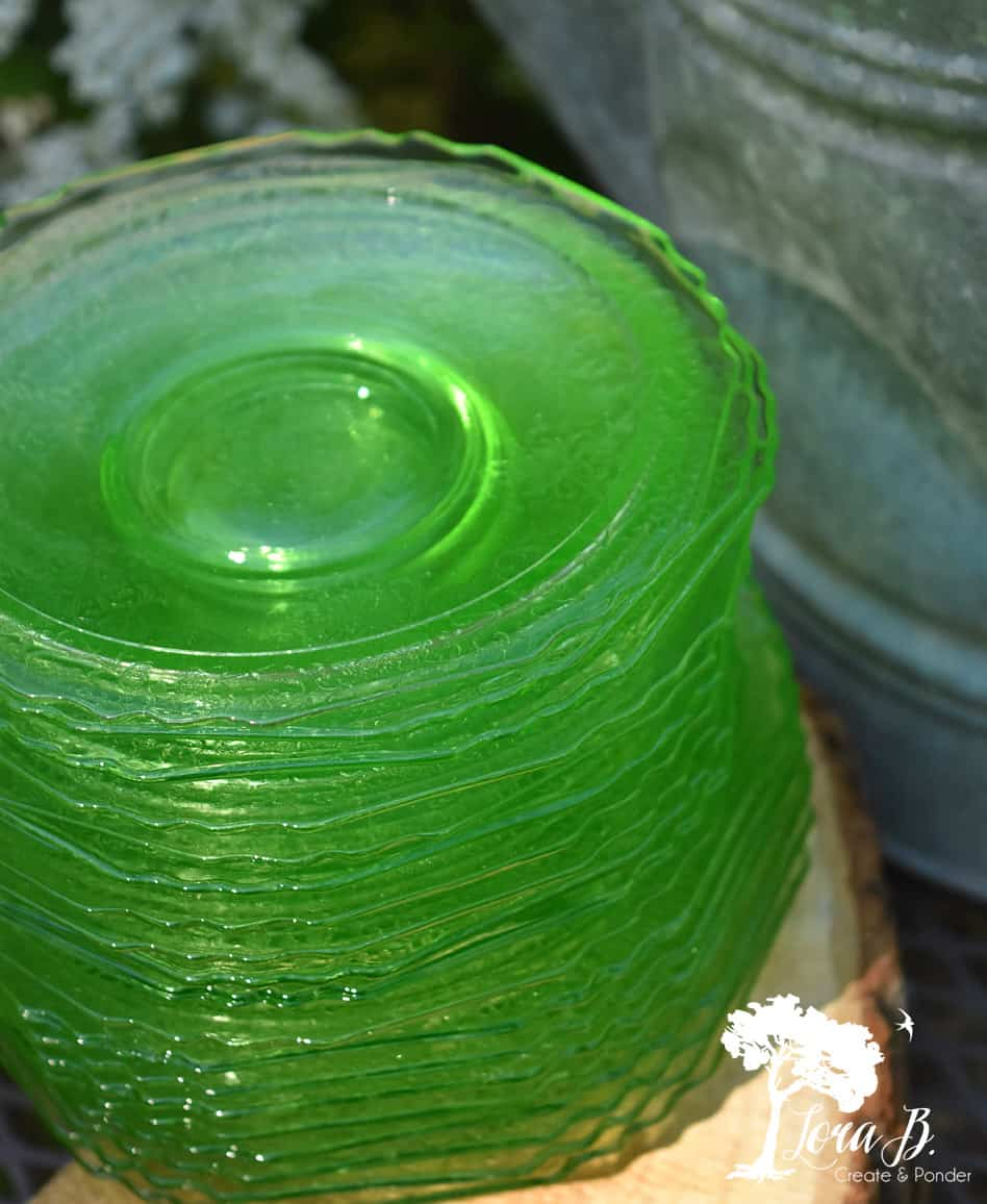 Green Depression glass saucers and salad plates.