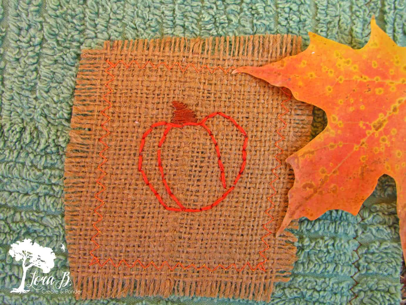 Needlepoint pumpkin on burlap