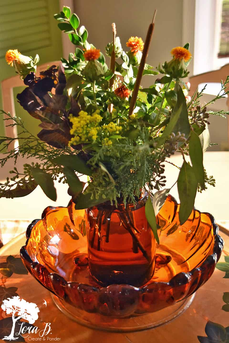 Store bought flower bouquet arranged in brown glass container.