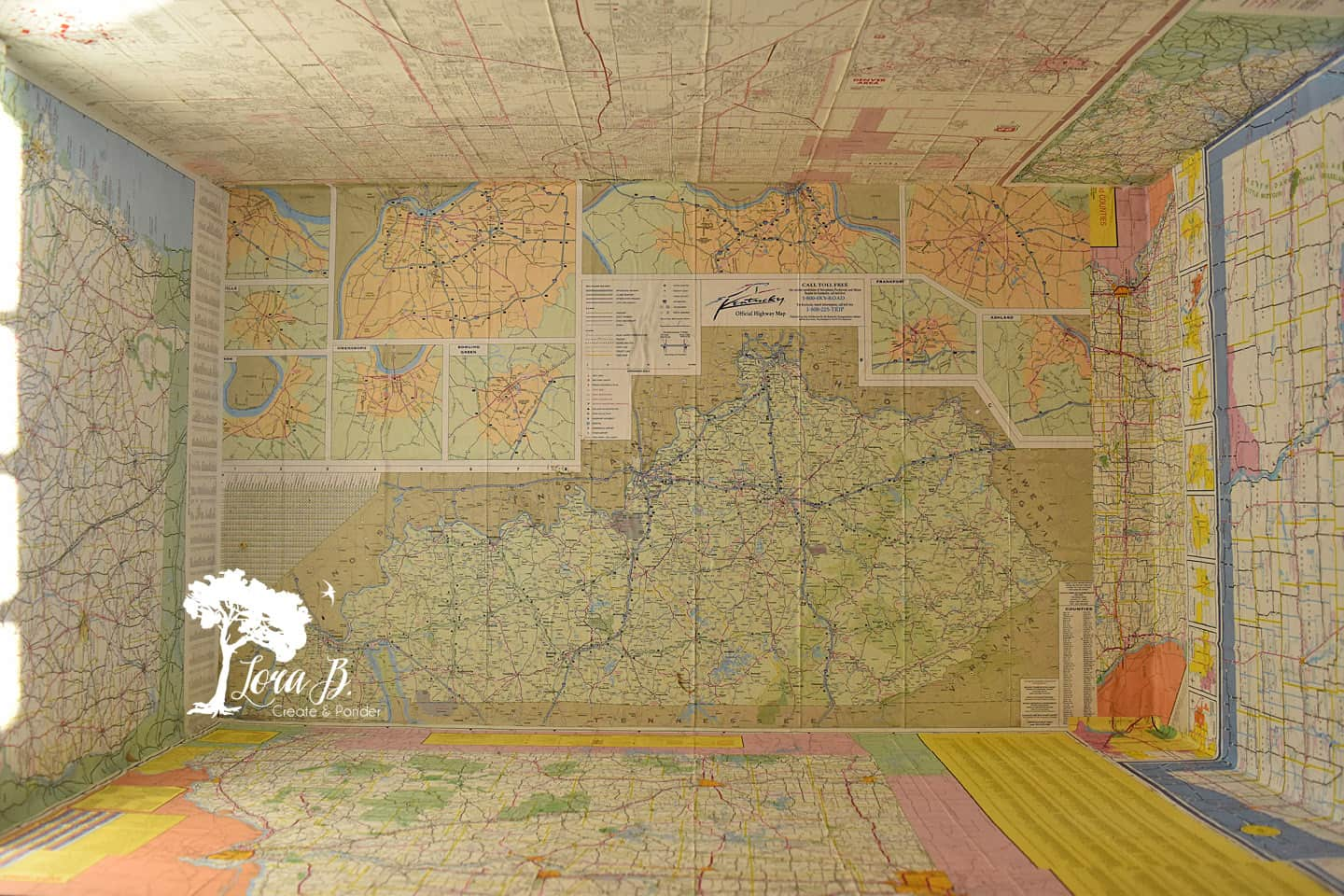 Decoupaged vintage maps inside an antique trunk.