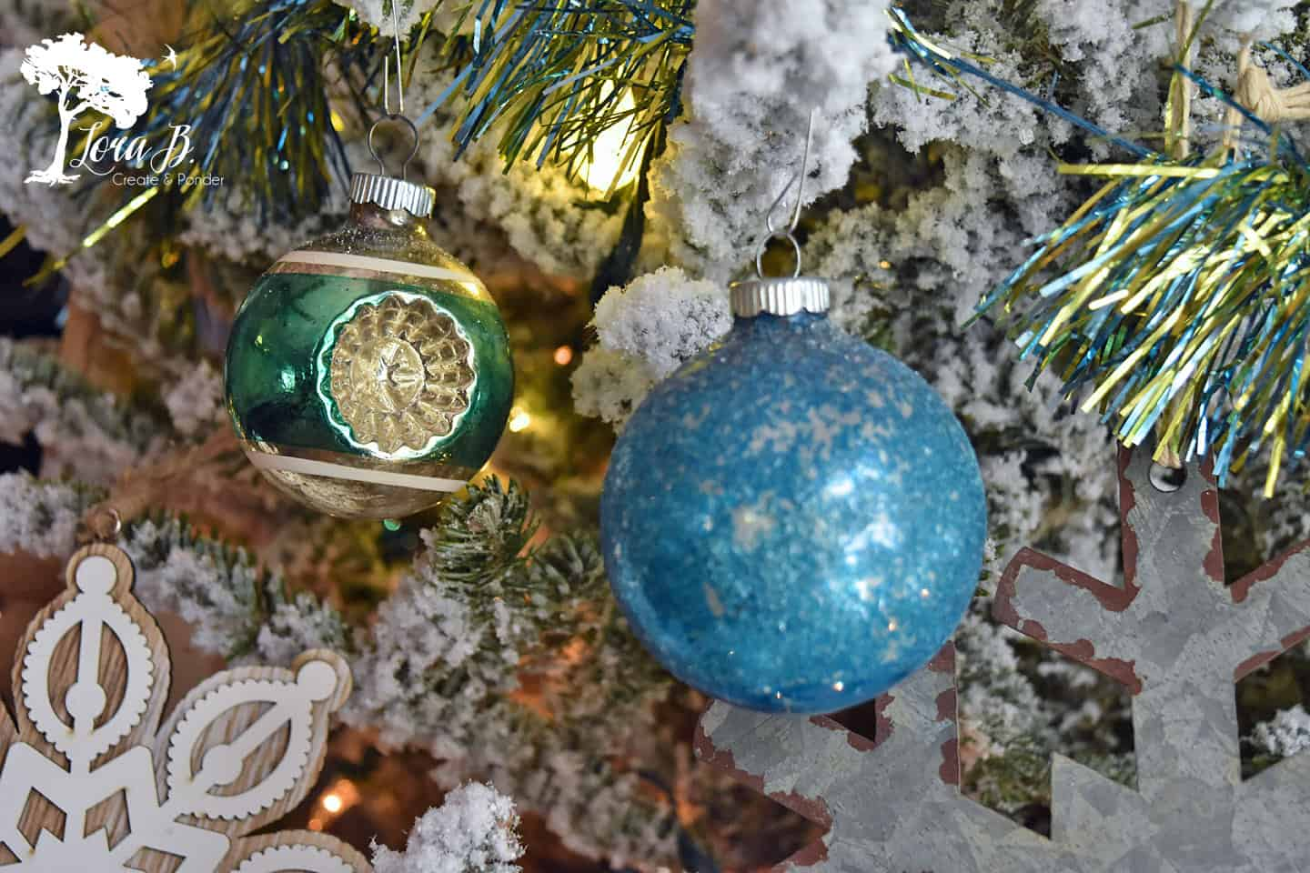 Vintage Shiny Brite ornaments on a Christmas tree.