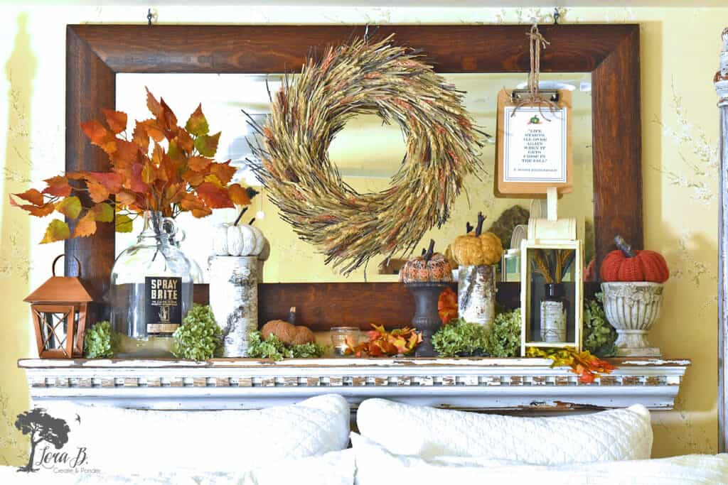 A shelf above the bed is the perfect place to decorate with natural accents in this Fall decorated bedroom.