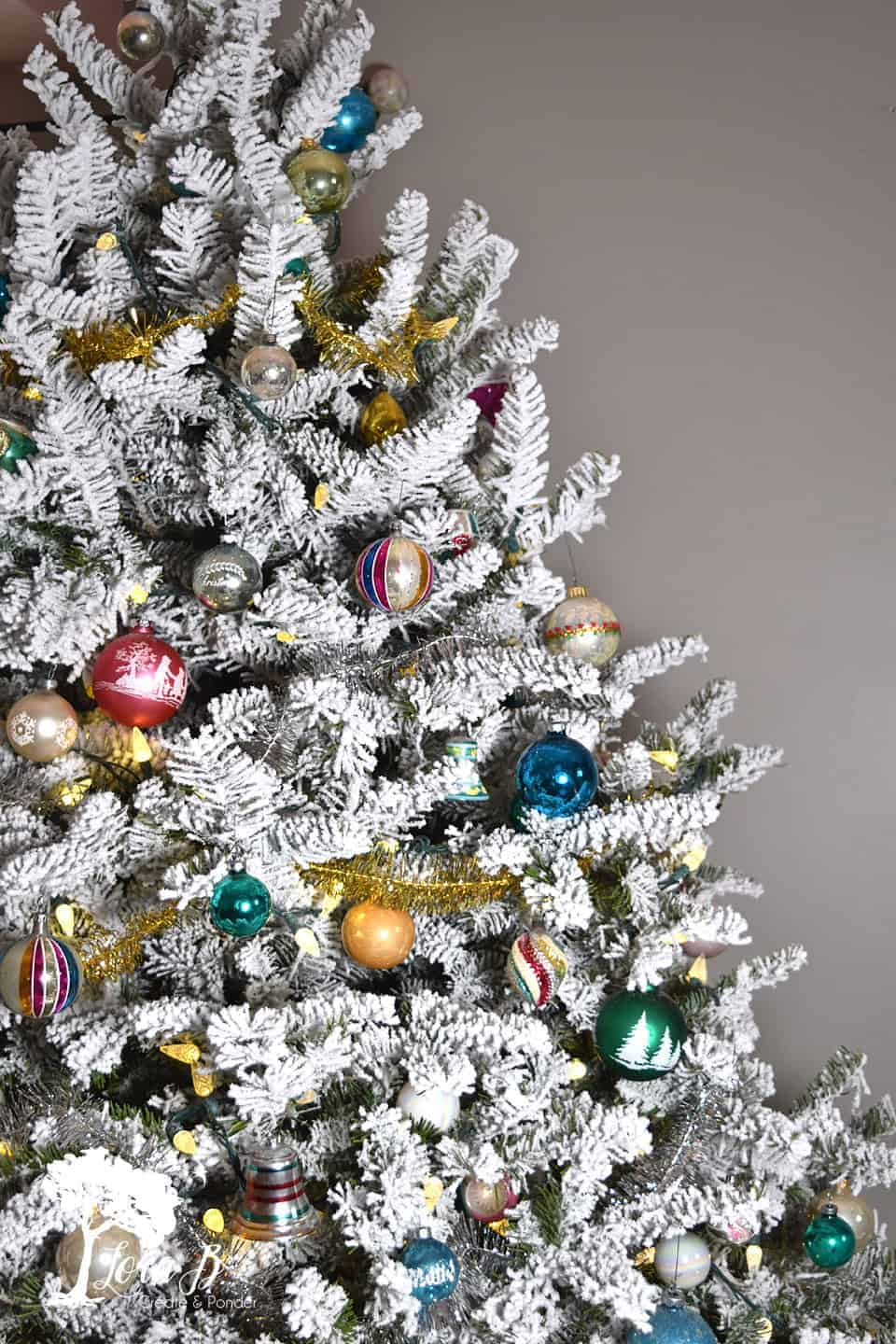 flocked Christmas tree with shiny brites