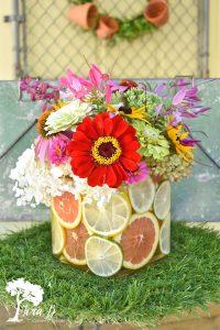 citrus and garden flowers arrangement