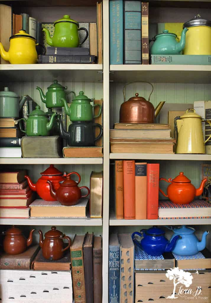 Vintage teapot collection displayed creatively.