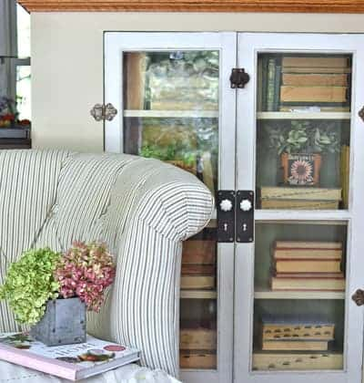 Vintage bookcase with old books and loveseat