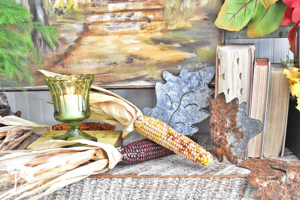 Natural decorative corn adds a rustic touch to a Fall mantel display.