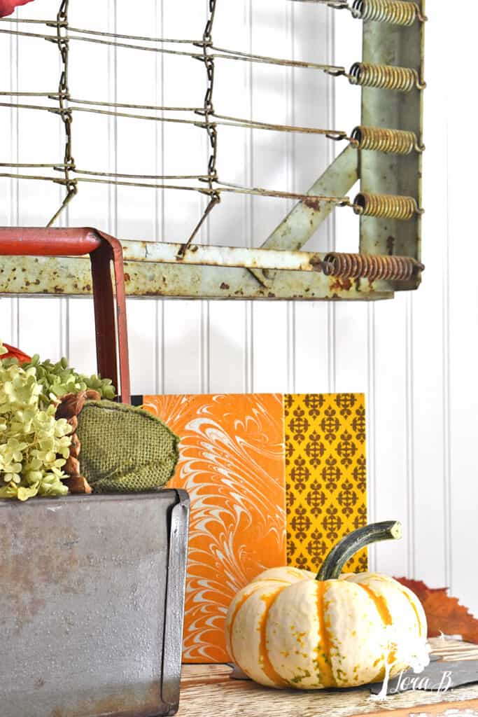 Vintage books add graphic punch to a Fall Mantel display.