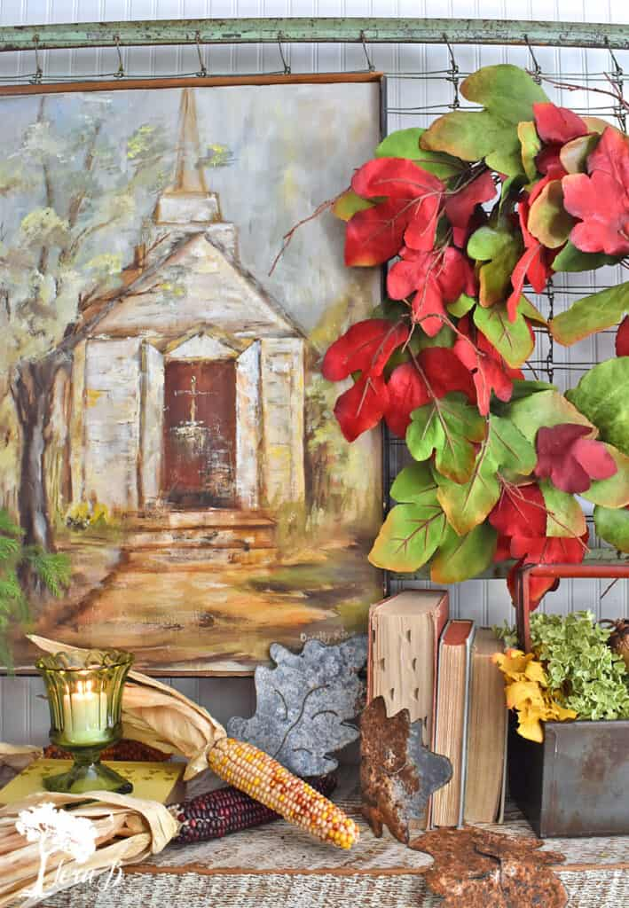 Handpainted old church art is the foundation for this Fall Mantel display.