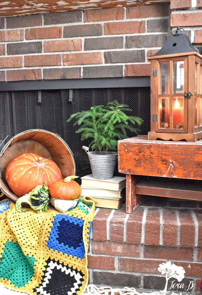 Vintage boho afghans provide softness for a decorated Fall mantel display.