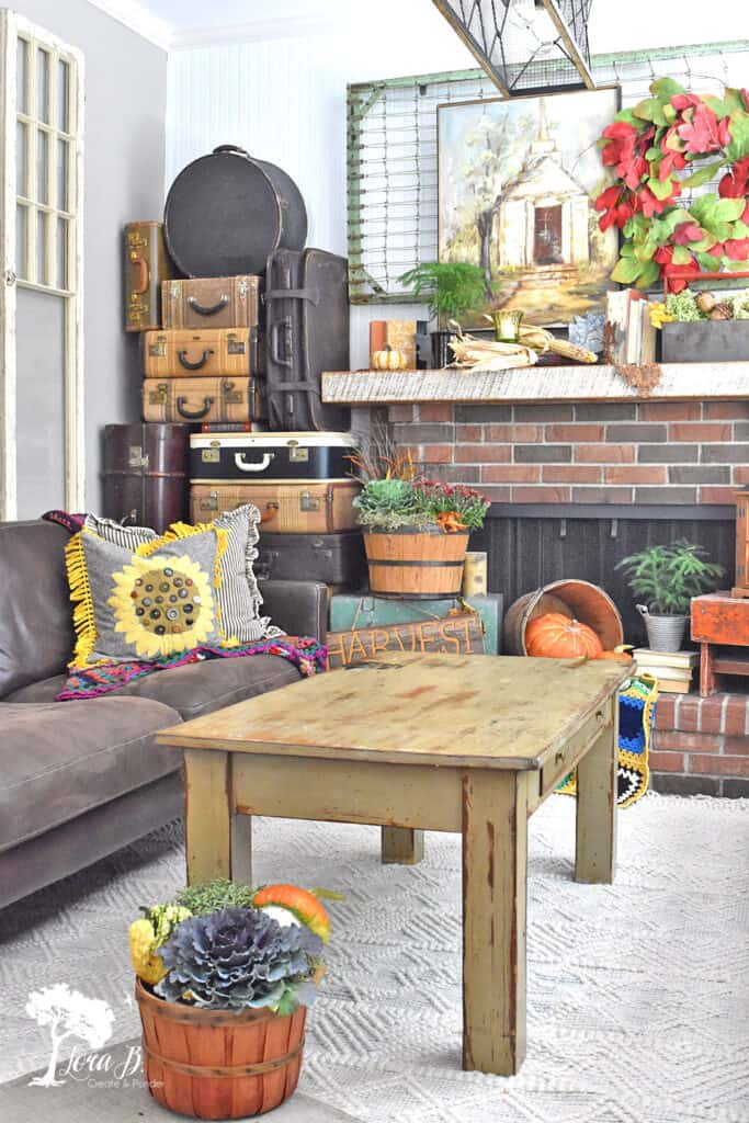 Vintage and rustic accessories combine for a decorated Fall Mantel display.