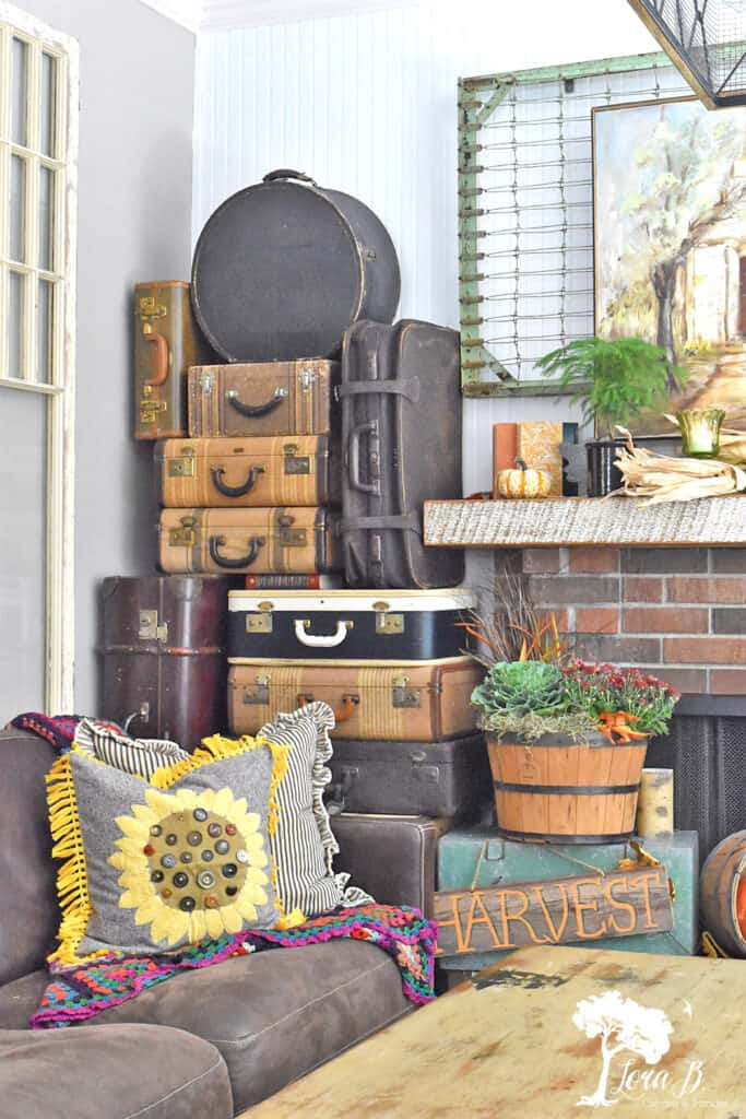 Vintage suitcase collection decorate a Fall Mantel display.