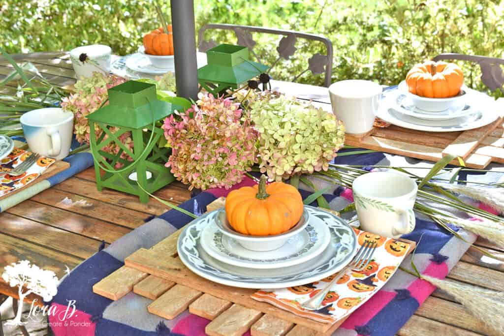 Vintage dishes set a table on a Fall decorated Porch and Patio with Salvaged Style