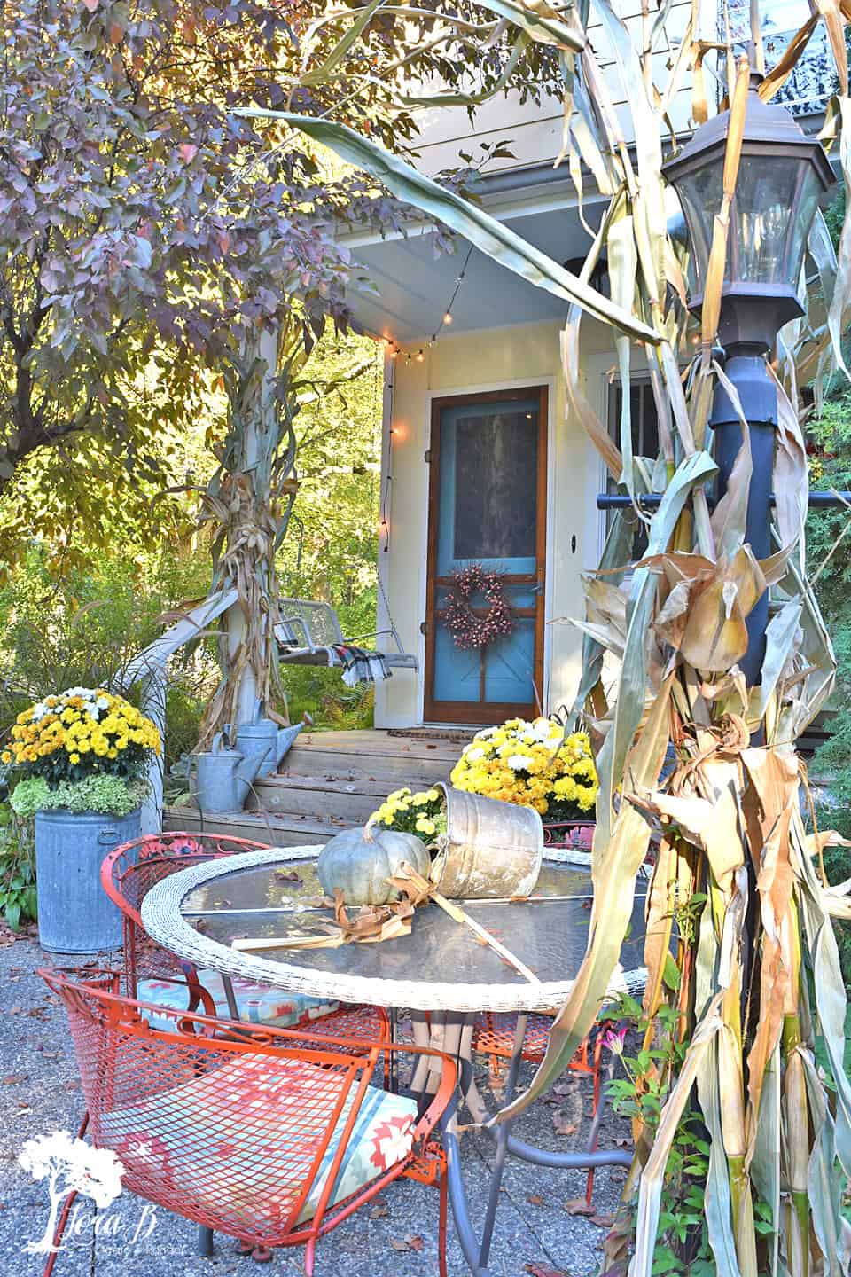 Fall Decorated Porch and Patio with Salvaged Style