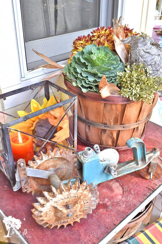 Vintage tractor sprinkler on a fall decorated porch and patio tour.