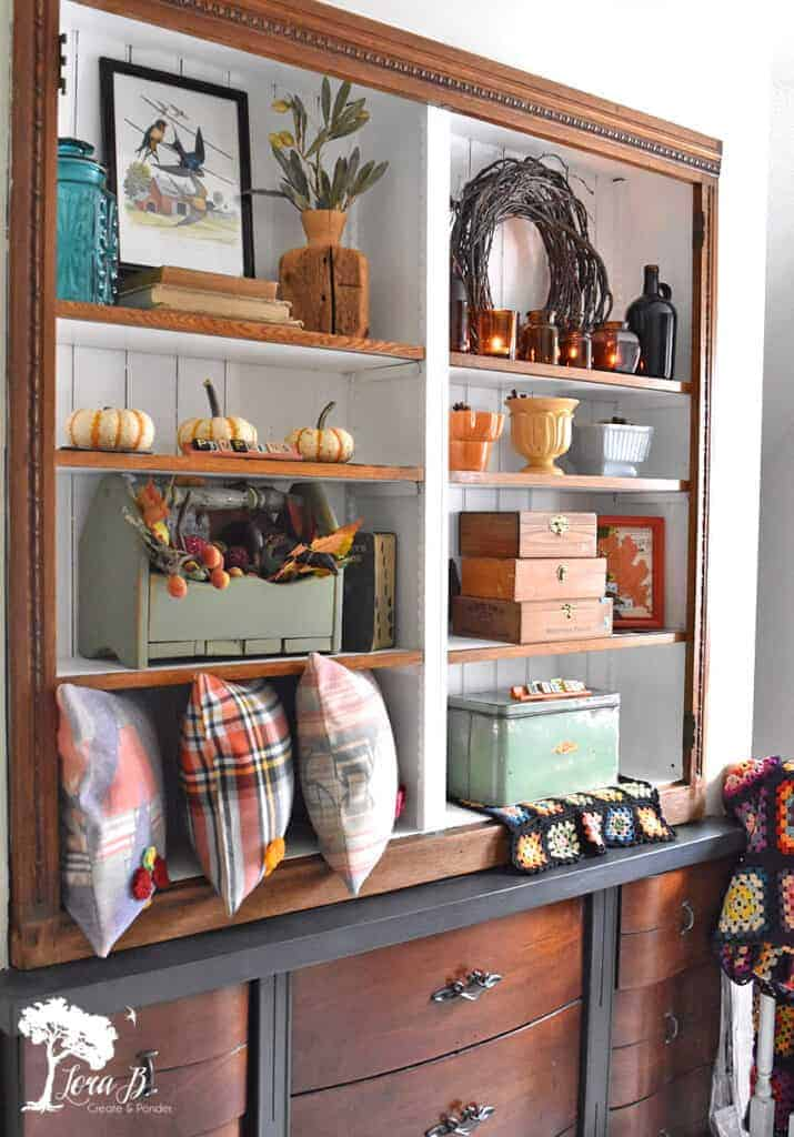 Fall colored accessories fill this cabinet display idea.