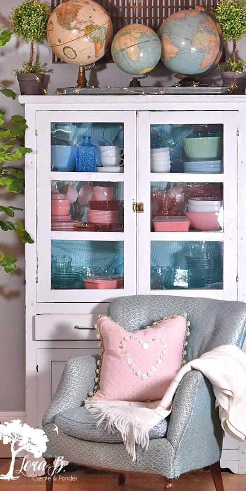 Glass front cabinet display ideas, showcasing a vintage Fire King dishware collection.