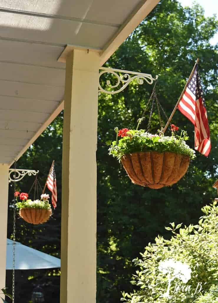 Stick flags in your outdoor flower pots for Patriotic decor.