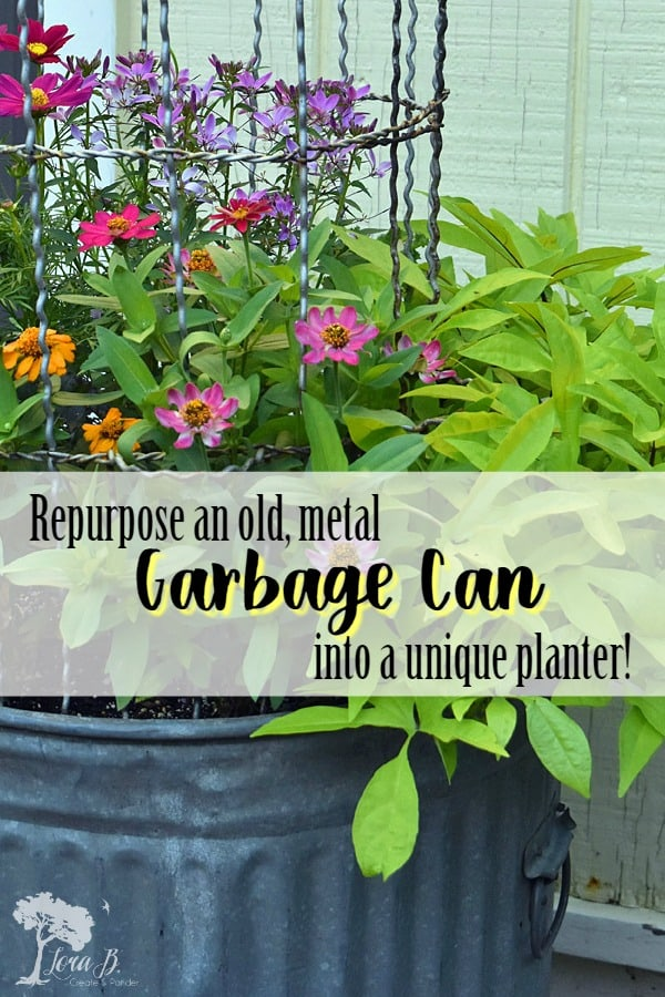 Repurpose an old, metal garbage can as a unique planter. Add vintage fencing for extra charm. True trash to treasure container gardening! #repurposed #vintage #junkygardens #reuse #upcycled #containergardening