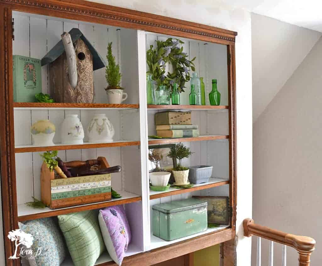 Spring colored accessories fill this cabinet display idea.