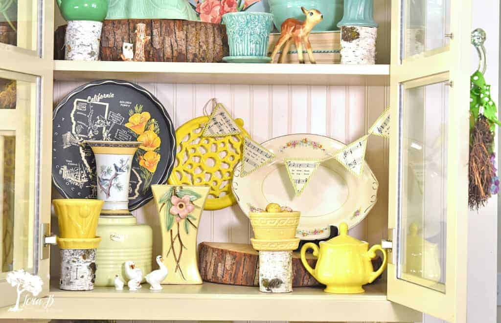 Tips for beautifully styling glass front cabinet displays.