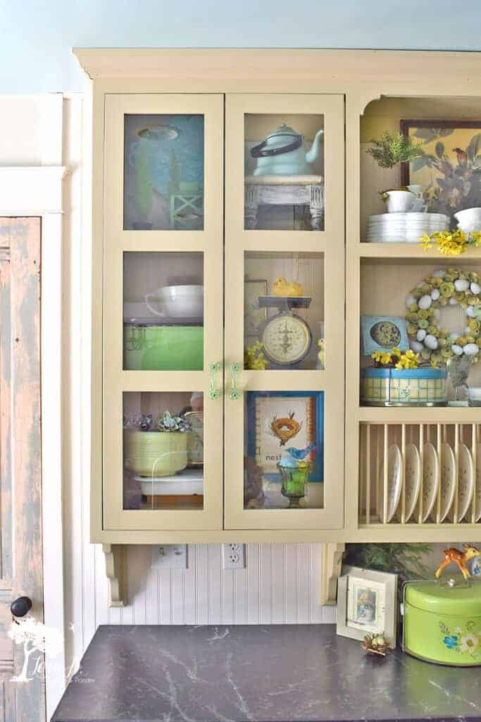 Kitchen glass cabinet display ideas featuring Spring vintage accessories.
