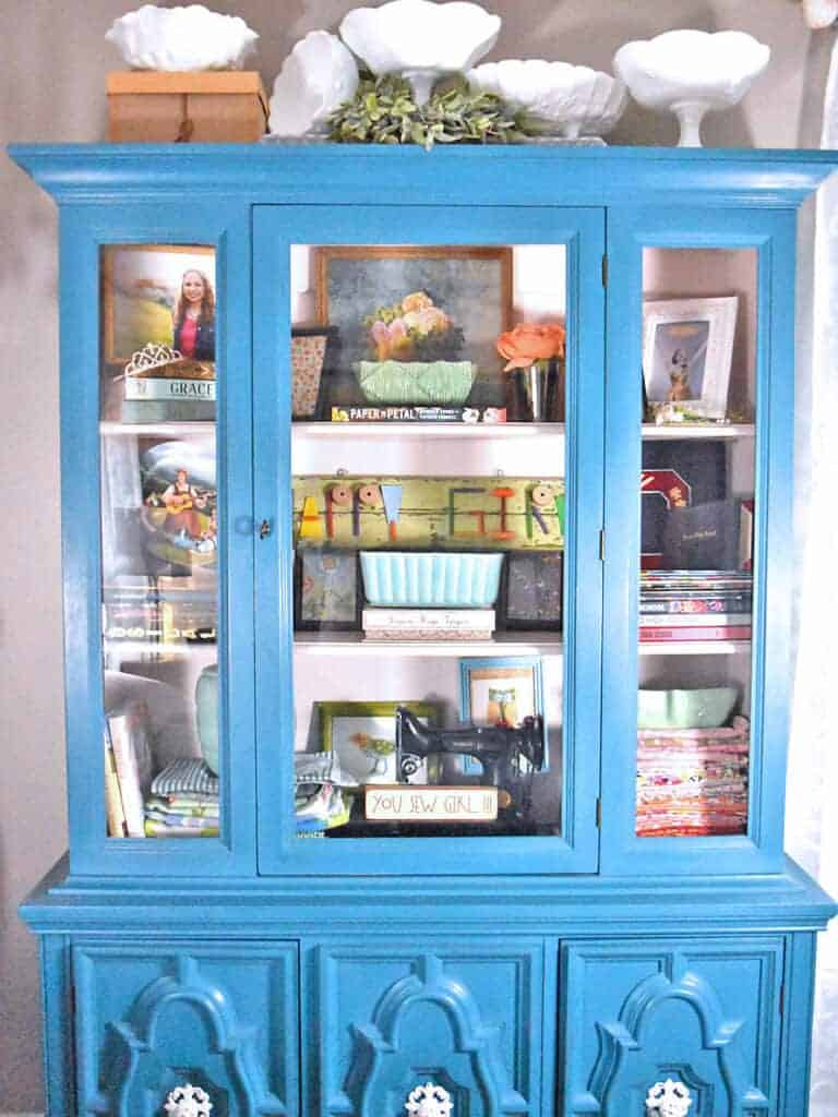 Glass front cabinets and cupboards can be a great display space for any room, like this refreshed vintage aqua painted piece.