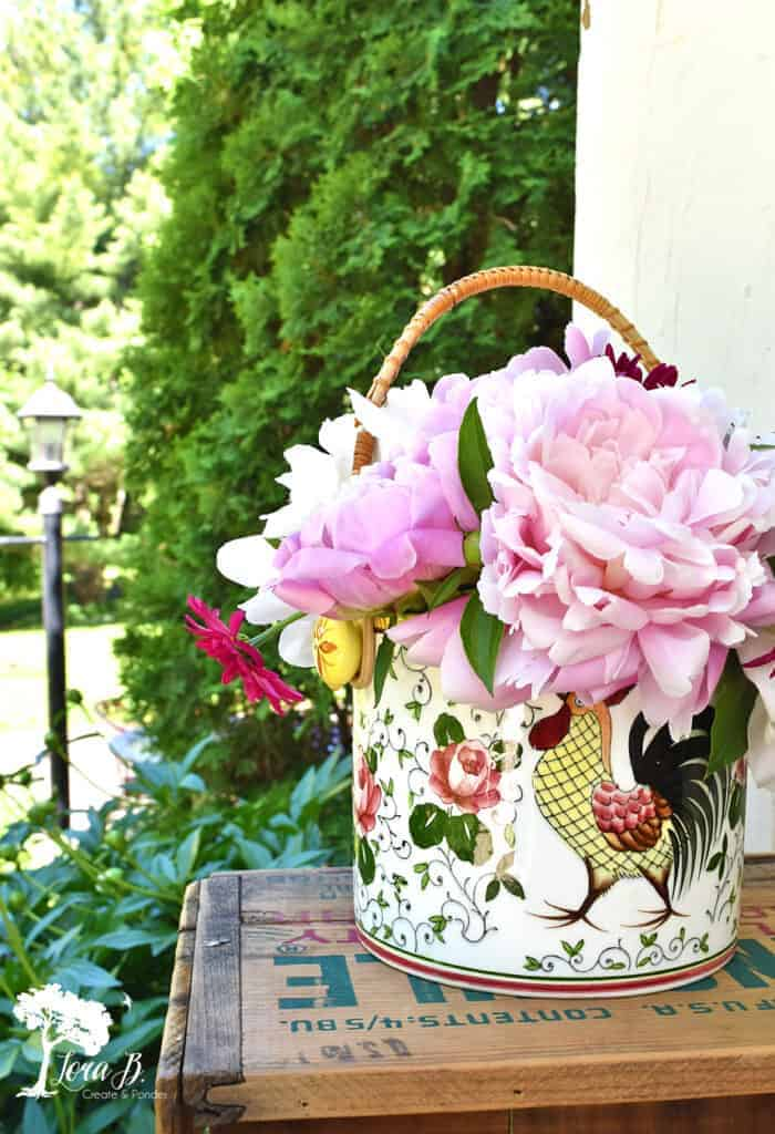 Pretty fresh cut peonies in a vintage rooster container.