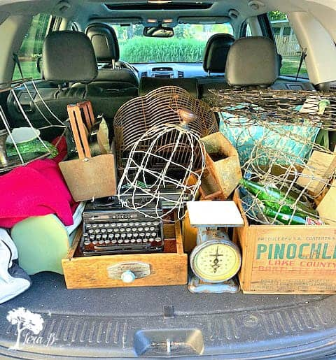 Trunkload of vintage props for photo styling tips using vintage and flowers