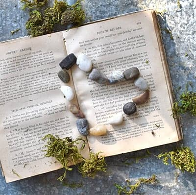 Rock heart and old book.