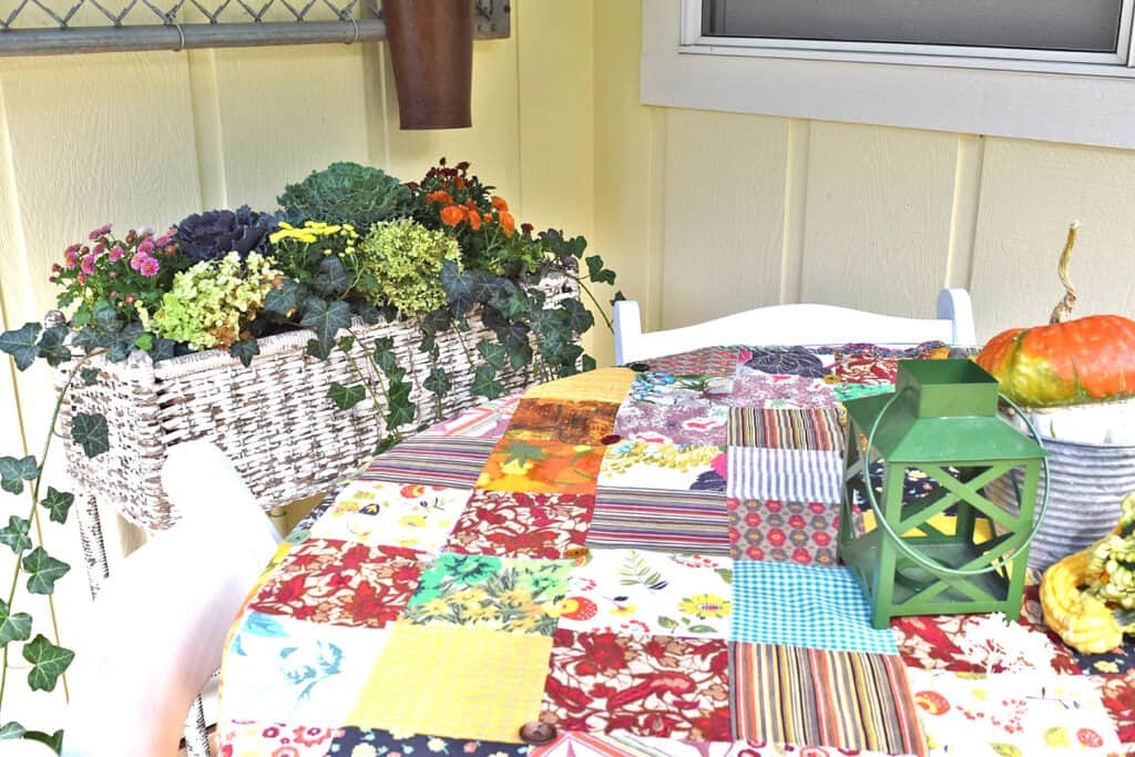 A vintage patchwork quilt, one of my recent vintage finds, is fun for a Fall tablecloth.
