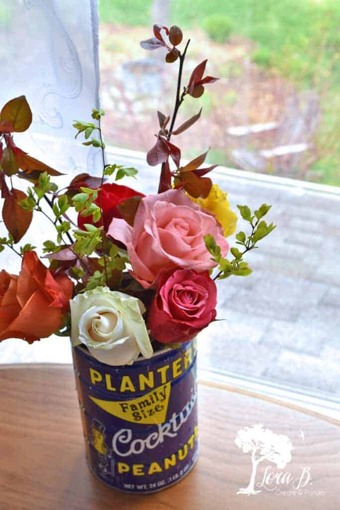 roses in vintage Planter's can