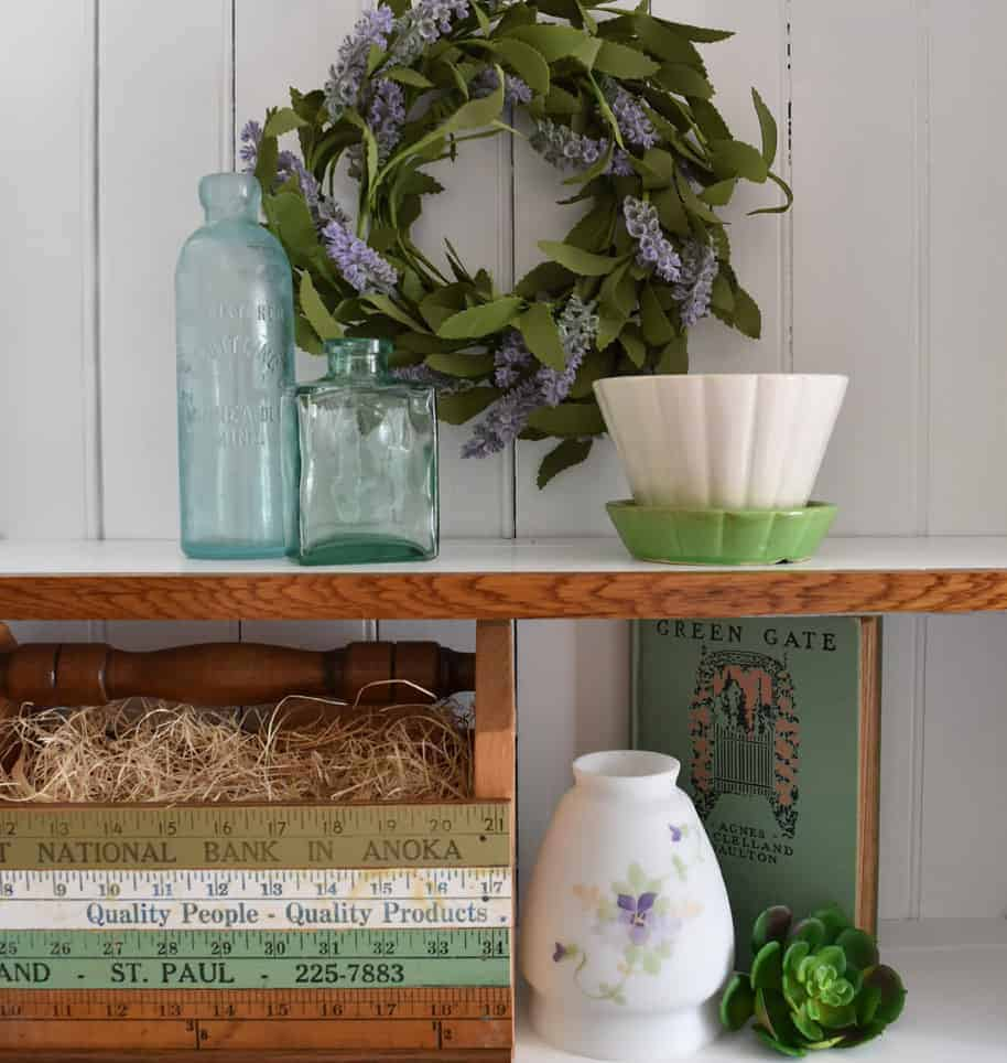 Glass front cabinet display ideas include using various texures, seen here with vintage finds.