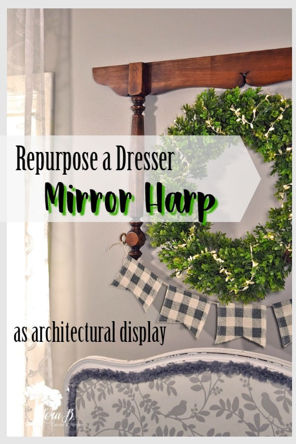 A vintage dresser's mirror harp can be repurposed as an architectural foundation for unique home decor wall art. Add a pretty wreath and bunting for a beautiful vignette. #vintagedresserrepurposed #mirrorharprepurpose #repurposedfurniture #upcycledfurniture #homedecor #homedecor #walldisplayideas #wreathideas #wreaths #buntingideas #DIYbunting #DIYhomedecor #DIYvintage #DIYvintagehomedecor