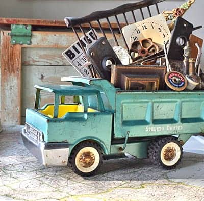 Vintage toy truck with antiques and junk.
