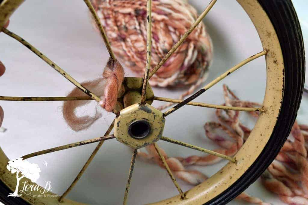 how to repurpose a vintage wheel into a pumpkin